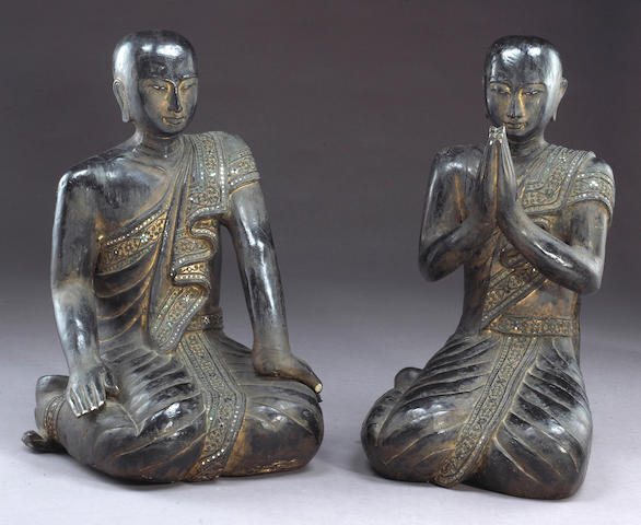 A pair of Burmese black lacquered wood seated monks