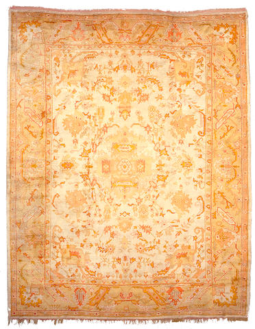 An Oushak carpet West Anatolia,  Size approximately 16ft 8in x 13ft