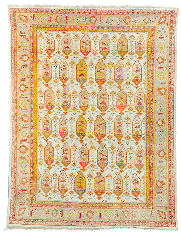 An Oushak carpet West Anatolia, Size approximately 18ft 7in x 14ft