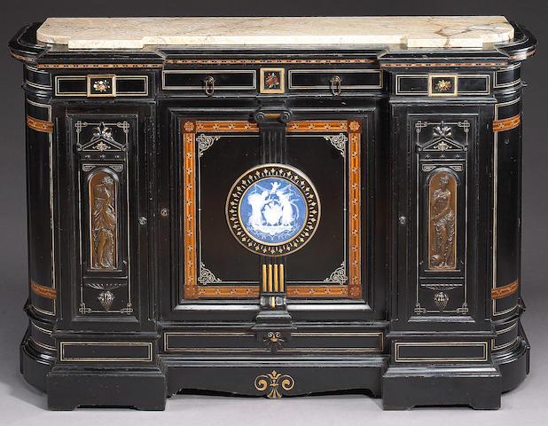 A Renaissance Revival parcel gilt pâte-sur-pâte, pietre dure and bronze mounted ebonized cabinet