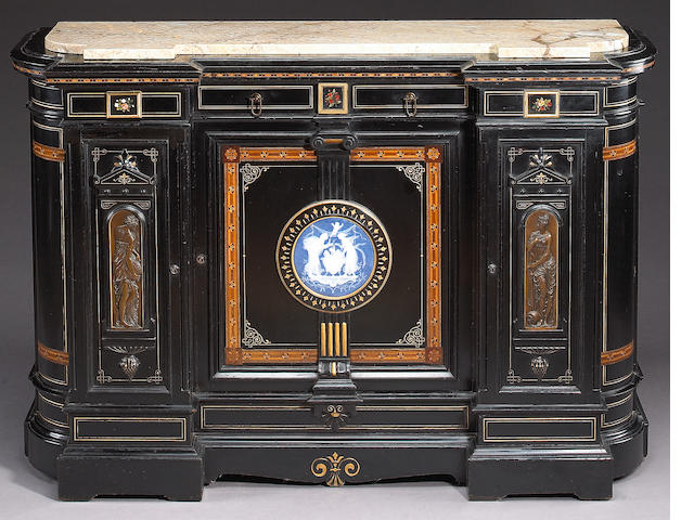 A Renaissance Revival parcel gilt pâte-sur-pâte, pietre dure and bronze mounted ebonized cabinet