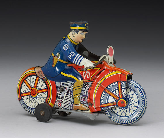 A good Motorcycle Police Patrol tinplate clockwork toy, by Louis Marx & Co, American 1930s,