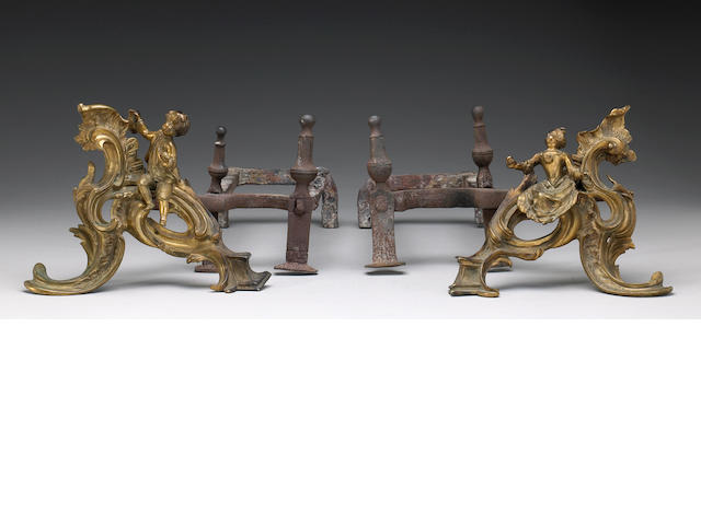 A pair of Louis XV style gilt bronze chenets, Late 19th century
