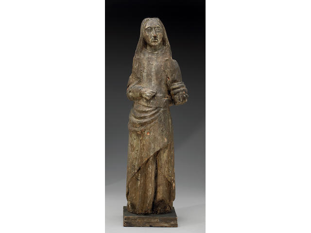 A European carved and painted wood figure of St. Mary Magdalene