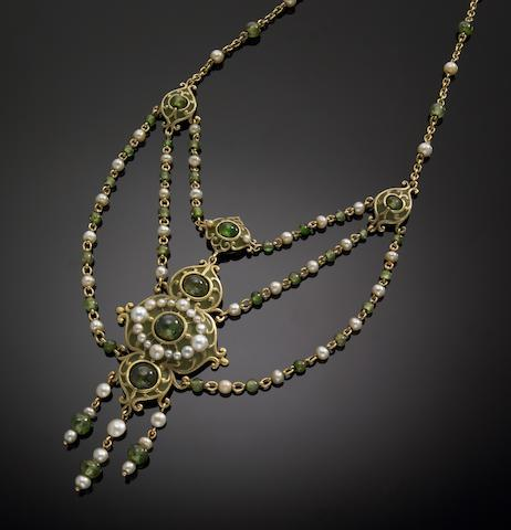 An arts & crafts cultured pearl, demantoid, enamel and fourteen karat gold necklace, Marcus & Co.