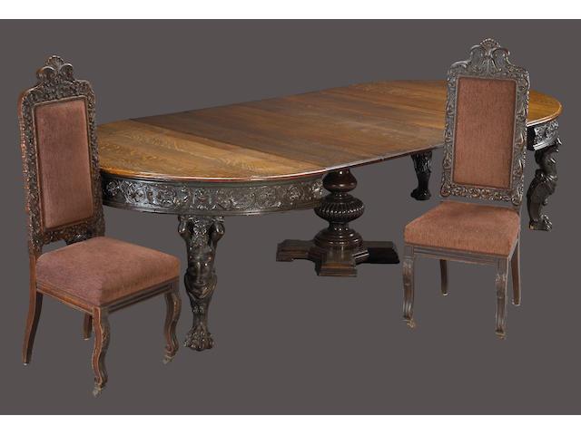 An Italian Renaissance style oak dining suite