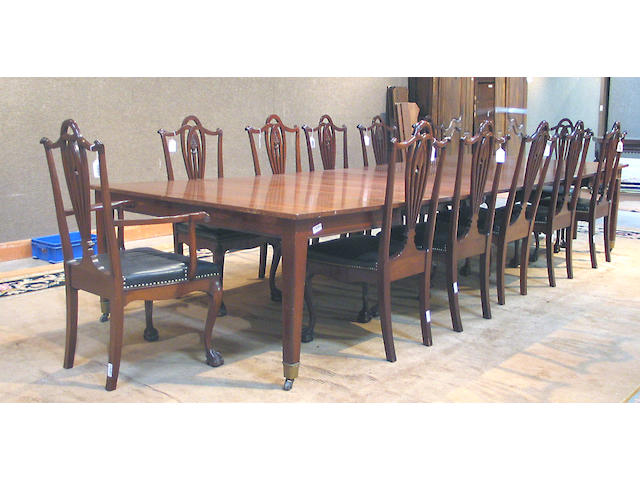 An assembled George III style mahogany dining suite, comprising an extension table, two armchairs and ten side chairs