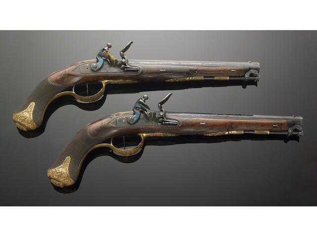 "A pair of composite flintlock pistols owned by Ceceil B. Demille and used by Gary Cooper in ""The Unconquered"""