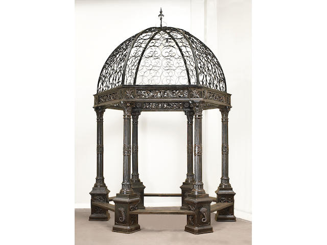 A Baroque style cast and wrought iron gazebo