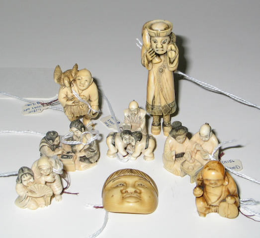 Eight ivory and marine ivory netsuke