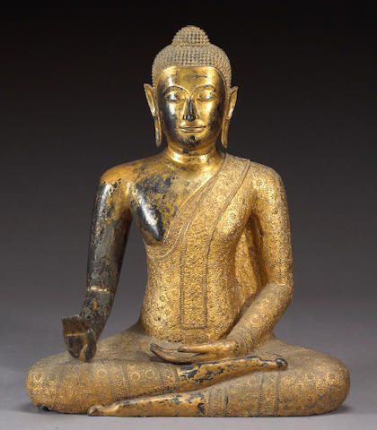 A large Thai gilt bronze seated Buddha