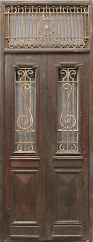A pair of Neoclassical style paint decorated and wrought iron mounted doors