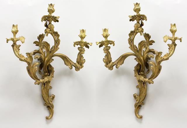 A pair of Louis XV style gilt bronze bras de lumiere