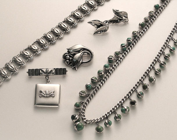 A collection of silver jewelry
