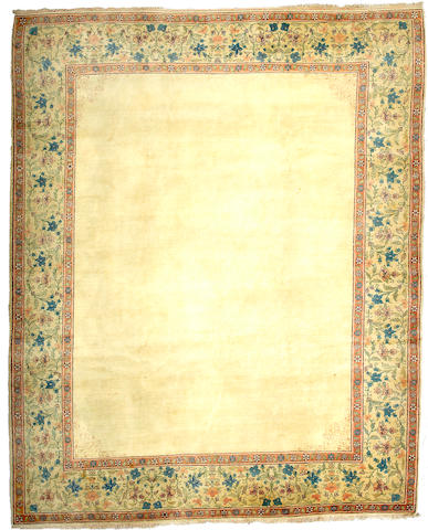 A Tabriz carpet Central Persia, Size approximately 11ft 2in x 9ft