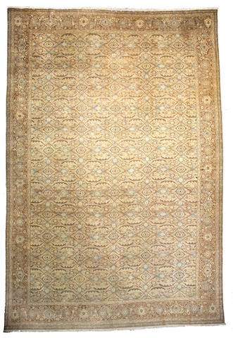 A Tabriz carpet Northwest Persia, Size approximately 16ft 10in x 11ft 4in