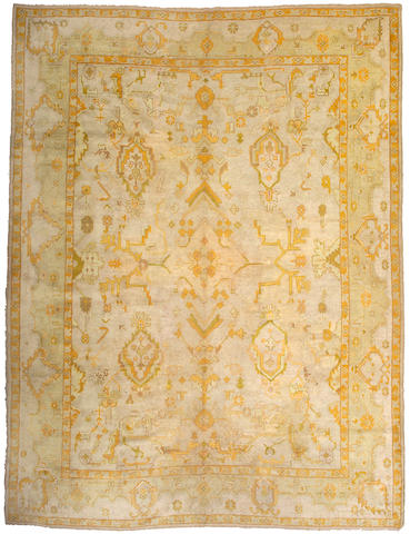 An Oushak carpet West Anatolia, Size approximately 13ft 2in x 10ft