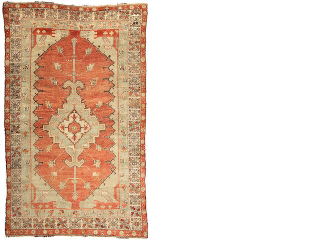 An Oushak rug West Anatolia, Size approximately 9ft 5in x 6ft