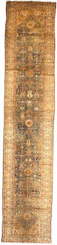 A Malayer runner Central Persia, Size approximately 17ft x 3ft 6in