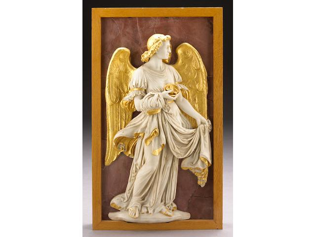 A carved white marble and parcel gilt relief panel of an angel with dice and cloak on a faux rosso antico ground