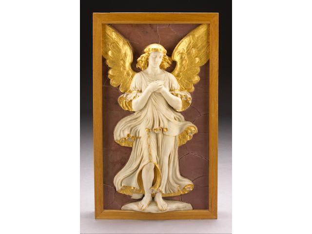 A carved white marble and parcel gilt relief panel of an angel with arms crossed in prayer on a faux rosso antico ground