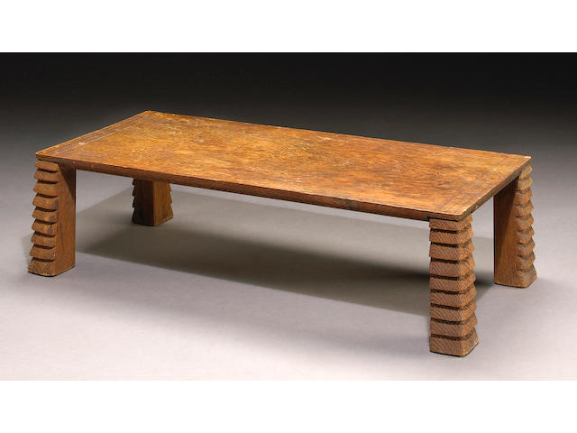 A fine and rare Jean-Michel Frank carved and sanded oak table