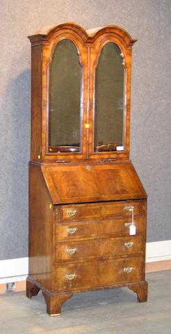 A Queen Anne style walnut secretary bookcase