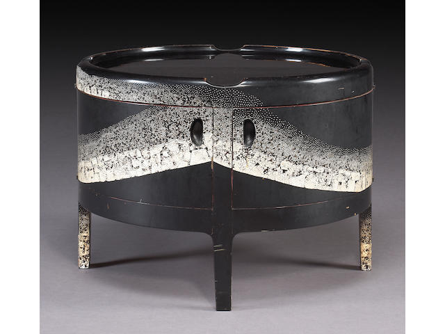 A fine and rare Jean Dunand eggshell lacquer drum table
