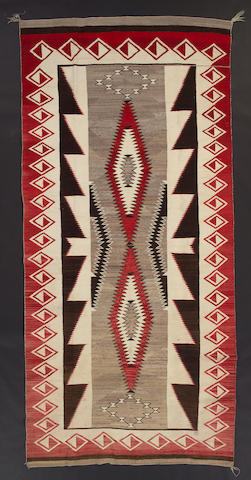 A large Navajo rug, 11ft 5in x 5ft 4in