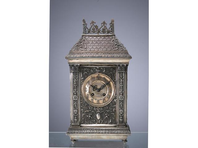 A Renaissance Revival silver cased mantel clock
