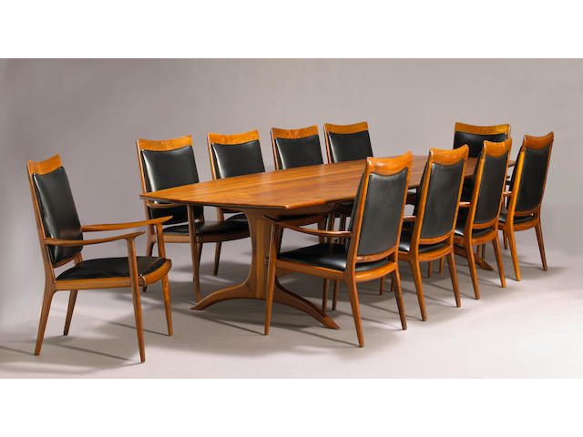 A fine Sam Maloof carved walnut conference table and en armchairs