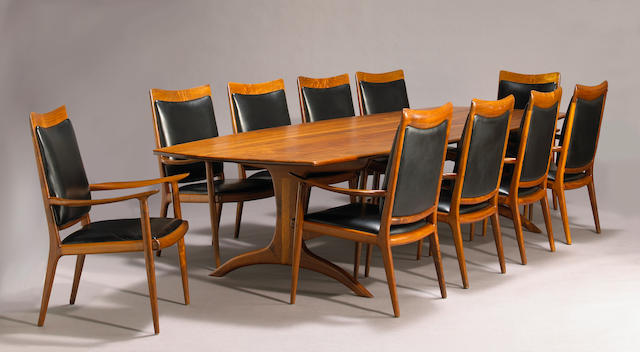 A fine Sam Maloof carved walnut conference table and ten armchairs