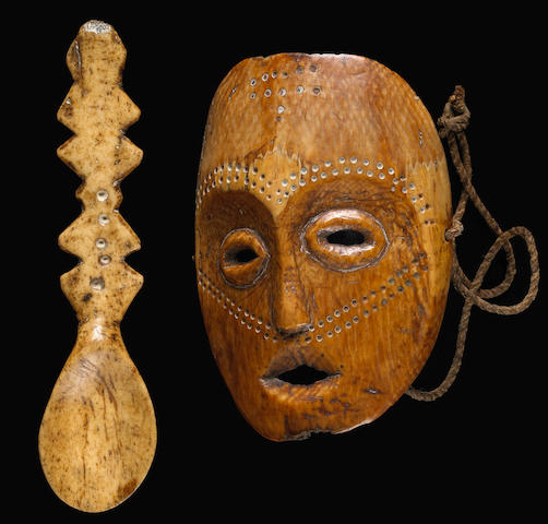 A Lega Bwame Society ivory maskette and a bone spoon