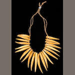 A Fijian man's ivory necklace and two South Seas fishhooks