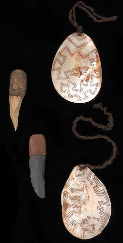 Four Australian Aborigine implements: two stone knives, two pearl shells