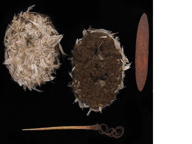 An unusual Australian Aborigine ritual kit: Kurdaitcha shoes, pointing bone, wood churinga