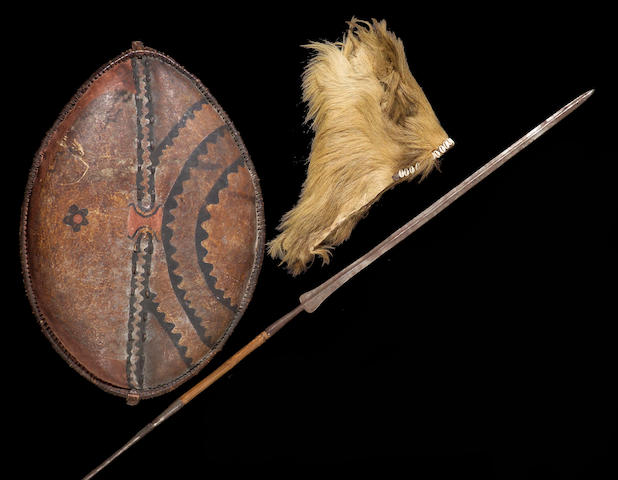 "A group of Nandi items: shield, headdress; spear; ""Africa Speaks"" book; collection notes"