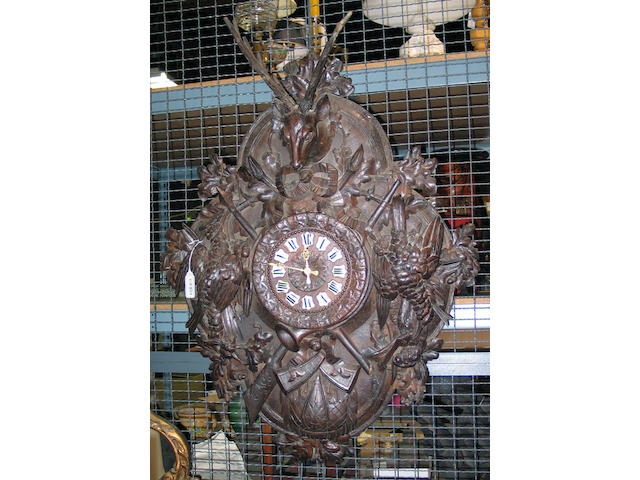 A large Black Forest carved walnut wall clock