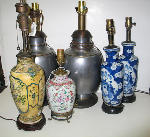 A group of four Chinese porcelain vases and a pair of pewter canister, each now mounted as table lamps