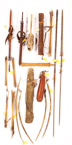 A collection of African items: arrowheads & arrowshafts, spears (2), sword-sidearms (2), bows (4), quivers (2), gourd, instrument, knife and sheath