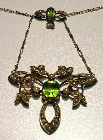 An art nouveau peridot, cultured seed pearl and fifteen karat gold pendant necklace