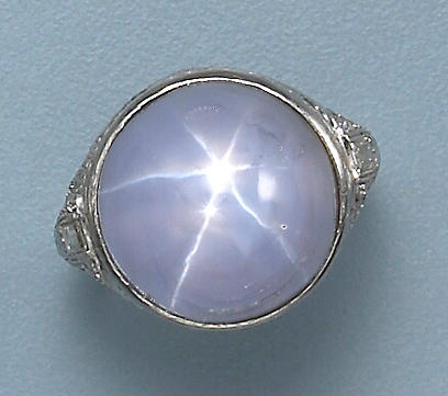 An art deco star sapphire, diamond and platinum ring,