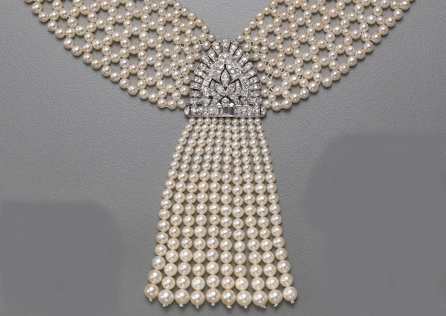 A cultured pearl, diamond, white gold and platinum necklace