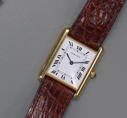 An eighteen karat gold tank wristwatch, Cartier,