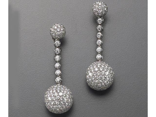 A pair of diamond and eighteen karat white gold drop earrings, deGrisogono