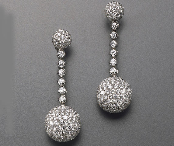 A pair of diamond and eighteen karat white gold drop earrings, deGrisogono