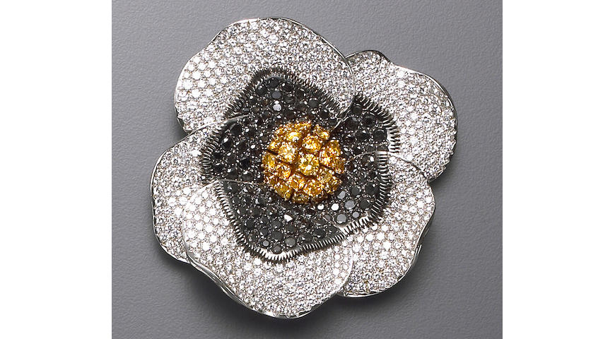 A black diamond, diamond, and eighteen karat white gold floral brooch, deGrisogono