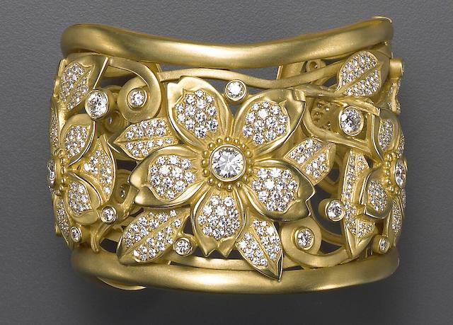 A diamond and eighteen karat gold bangle bracelet, Kieselstein Cord