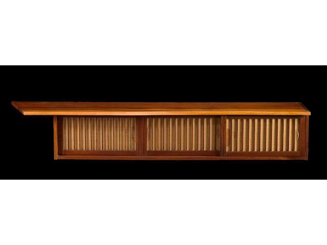 A fine George Nakashima walnut wall-hanging cabinet
