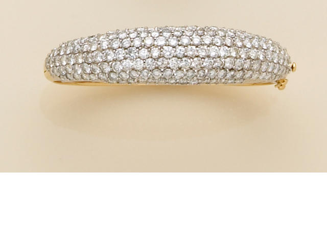 A diamond and eighteen karat gold bangle bracelet